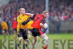 Brian Scanlon(15) of Listowel Emmets tries to hold back Jason Wren(7) of Tarbert in the North Kerry Senior Football Final held last Sunday in Bob Stack Park, Ballybunion.