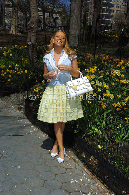 WWW.ACEPIXS.COM ** ** ** ....NEW YORK, APRIL 15, 2005....After appearing on Live with Regis and Kelly, Mariah Carey makes her way through a throng of waiting fans. She exits gracefully and then heads into a upper west side building with a brass plaque that denotes some part of the building as a doctors office for 'Ear, Nose, and Throat' 'Care of the Professional Voice.' She then heads to Central Park where she meets a wheelchair bound fan named Karyne who came all the way from Montreal because she knew that Mariah would be making guest appearances in New York this week. Mariah Carey chats with Karyne before taking her new puppy for a walk. During the daffodil lined walk, the puppy takes a moment to use the bathroom. Mariah seems a little agitated that the puppy has made a mess of the photo shoot, but hands the puppy off and regains her composure. She later finishes walking the puppy and bids farewell to our photographer.....Please byline: Philip Vaughan -- ACE PICTURES... *** ***  ..Ace Pictures, Inc:  ..Craig Ashby (212) 243-8787..e-mail: picturedesk@acepixs.com..web: http://www.acepixs.com