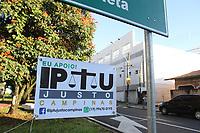 CAMPINAS, SP, 07.02.2019: IPTU-CAMPINAS - Em protesto contra o aumento do IPTU em Campinas, moradores da região do Pq. Prado colocam placar contra o aumento do imposto na cidade. As placas estão espalhadas pela avenida Washington Luis. (Foto: Luciano Claudino/Código19)