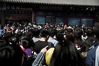 Tourists crowd around the Badaling entrance to the Great Wall outside of Beijing, China.