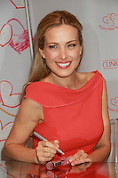 NEW YORK, NY - DECEMBER 14: Petra Nemcova celebrates a new partnership with Clinique and her global charity, Happy Hearts Fund, with a holiday appearance at Bloomingdale's 59th Street Store on December 14, 2012 in New York City. Credit: RW/MediaPunch Inc. /NortePhoto