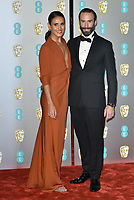 Maria Dolores Dieguez and Joseph Fiennes<br /> The EE British Academy Film Awards 2019 held at The Royal Albert Hall, London, England, UK on February 10, 2019.<br /> CAP/PL<br /> ©Phil Loftus/Capital Pictures