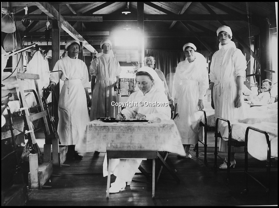 BNPS.co.uk (01202 558833)<br /> Pic: Onslows/BNPS<br /> <br /> Make shift hospital behind the Front Line. <br /> <br /> Poignant photographs revealing life on the Western Front during the First World War have emerged for sale 100 years after they were taken.<br /> <br /> The rare collection of snaps, taken in the early stages of the war, provide a moving insight into the lives of the soldiers serving on the front line.<br /> <br /> Among the archive of 70 original photographs are images of troops braving the freezing winter months in their fortified trenches at stations in France and Belgium.<br /> <br /> Particularly touching photographs show the barren 'no-man's land' between the British and German trenches.<br /> <br /> One fascinating shot shows a 'shell dump' - where 2ft tall artillery shells were stored in their hundreds while another shows soldiers manning rudimentary machine gun posts.<br /> <br /> In another, a soldier is seen loading a rocket onto a wooden launching pole which would then be fired to announce to impending attacks.<br /> <br /> The photographs are tipped to fetch 3,000 pounds when they go under the hammer at Onslows auction house in Blandford, Dorset, on July 9 on behalf of a private collector.