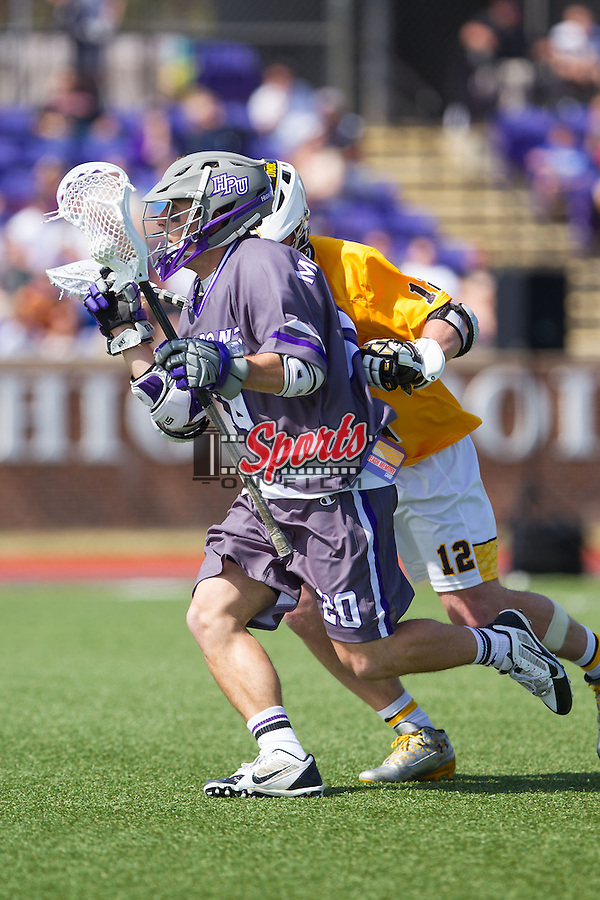 Brendan Montrello (20) of the High Point Panthers is checked by Kevin McDonough (12) of the UMBC Retrievers at Vert Track, Soccer & Lacrosse Stadium on March 15, 2014 in High Point, North Carolina.  The Panthers defeated the Retrievers 17-15.   (Brian Westerholt/Sports On Film)