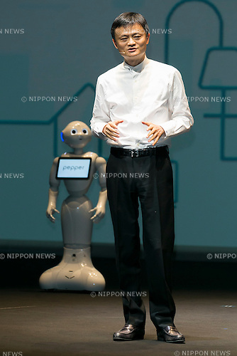Jack Ma executive chairman of Alibaba Group speaks during a press conference to announce that the SoftBank's robot ''Pepper'' can feel like a human on June 18, 2015, Tokyo, Japan. Masayoshi Son chairman & CEO of Japanese internet and telecommunications giant SoftBank Corp., announced that its robot Pepper can feel and understand people's emotions and also express itself. Son also said that the first 1000 robots will be on sale to the public for 198,000 JPY (1,604 USD) from Saturday June 20th, and could be available to companies to replace positions such as reception and convenience store staff from the beginning of July. To develop Pepper's skills SoftBank announced an alliance with foreign technology companies FOXCONN and Alibaba Group. (Photo by Rodrigo Reyes Marin/AFLO)