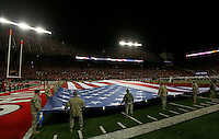 Members of the military display an American flag during the National Anthem prior to the NCAA football game at Ohio Stadium on Saturday, November 1, 2014. (Columbus Dispatch photo by Jonathan Quilter)