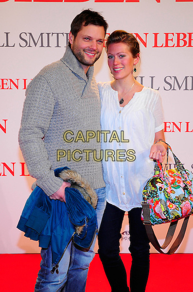 "PETER THORWARTH & CHRISTINA SCHULTE.German premiere for ""Seven Pounds"", CineStar Sony Center, Berlin, Germany..January 6th, 2009.half length grey gray white top jeans denim bag purse.CAP/PPG/NK.©Norbert Kesten/People Picture/Capital Pictures"