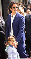 HOLLYWOOD, LOS ANGELES, CA, USA - APRIL 02: Flynn Christopher Bloom, Orlando Bloom at Orlando Bloom's star ceremony on the Hollywood Walk of Fame (2,521st star) in the category of Motion Pictures held at 6927 Hollywood Boulevard (next to TCL Chinese Theatre and Madame Tussauds Hollywood) on April 2, 2014 in Hollywood, Los Angeles, California, United States. (Photo by Celebrity Monitor)