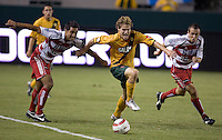 Los Angeles Galaxy's Chris Albright fends off FC Dallas's Arturo Alverez, left and David Wagenfuhr, right, at the US Open Cup, in the half at the Home Depot Center, in Carson, Calif., Wednesday, September 28, 2005.