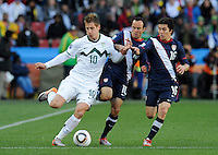 Valter Birsa (10) of Slovenia is surrounded by Landon Donovan (10) and Francisco Torres (16) of USA. USA vs Slovenia in the 2010 FIFA World Cup at Ellis Park in Johannesburg, South Africa on June 18th, 2010.