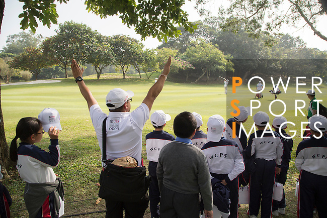 Children watch players in action during the 58th UBS Hong Kong Golf Open as part of the European Tour on 08 December 2016, at the Hong Kong Golf Club, Fanling, Hong Kong, China. Photo by Vivek Prakash / Power Sport Images