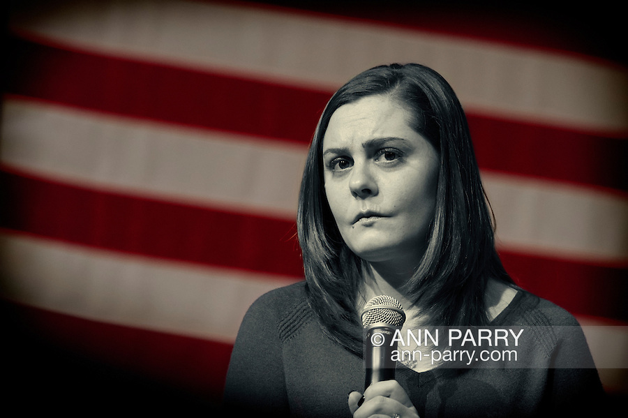 Port Washington, New York, USA. April 11, 2016. ERICA LAFFERTY SMEGIELSKI, who lost her mother Dawn Lafferty Hochsprungand, the Principal of Sandy Hook Elementary School in Newtown, CT, has serious expression as she shares her personal story of loss of a loved one due to gun violence, during a discussion with Hillary Clinton and other activists on gun violence prevention. HILLARY CLINTON, the leading Democratic presidential primary candidate, called for stricter gun control legislation. Clinton had several Long Island events scheduled this day, and the New York presidential primary is April 19.