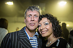 © Joel Goodman - 07973 332324 . 12/04/2015 . Manchester , UK . Bez and his partner Firouzeh Razavi backstage after the show . Black Grape perform a reunion gig in support of Bez's Reality Party at the Old Granada Studios Warehouse . Photo credit : Joel Goodman