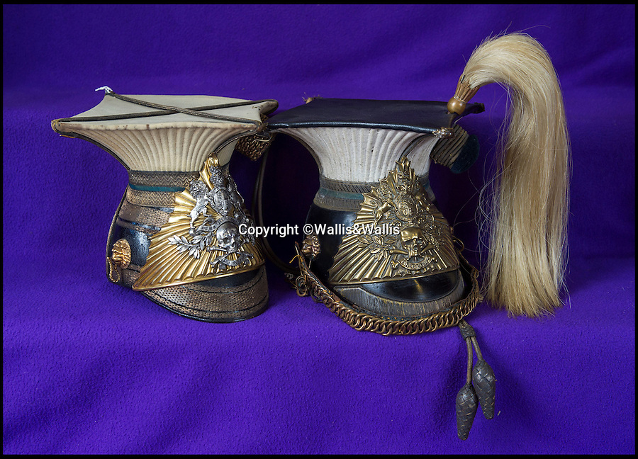 BNPS.co.uk ()1202 558833)<br /> Pic: Wallis&Wallis/BNPS<br /> <br /> l-r £10,000 - Officer's lance cap of the 17th Lancers, the 'Death or Glory boys'<br /> <br /> £10,000 - Sergeant Major's lance cap of the 17th Lancers  <br /> <br /> An extraordinary collection of artefacts and momentoes from one of the most infamous days in British military history is being sold at Wallis&Wallis auctioneers in genteel Lewes, East Sussex.