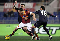 Calcio, Serie A: Roma vs Cagliari. Roma, stadio Olimpico, 1 febbraio 2013..AS Roma forward Francesco Totti, center, is challenged by Cagliari defender Luca Rossettini, right, and midfielder Albin Ekdal, of Sweden, during the Italian Serie A football match between AS Roma and Cagliari, at Rome's Olympic stadium, 1 February 2013..UPDATE IMAGES PRESS/Isabella Bonotto