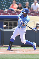 Omaha Storm Chasers Irving Falu (9) swings during the Pacific Coast League game against the Nashville Sounds at Werner Park on June 5, 2016 in Omaha, Nebraska.  Omaha won 6-4.  (Dennis Hubbard/Four Seam Images)