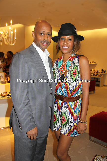 Ruben Santiago-Hudson (AMC, A/W and ATWT & Castle) poses with Sade Lythcott daughter of Barbara Ann Teer who was the founder of The National Black Theater were at The Innaugural Celebration of Color on Broadway Awards were held on June 9, 2011 at SAKS Fifth Avenue, New York City, New York. The event was held upstairs where beautiful shoes are sold and where a part of the sales this night will benefit OPUS 118 Harlem's School of Music. (Photo by Sue Coflin/Max Photos)