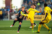 Matias Sanchez (8) of the Columbus Crew plays the ball away from Brian Carroll (7) of the Philadelphia Union during a Major League Soccer (MLS) match at PPL Park in Chester, PA, on June 5, 2013.