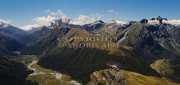 Helicopter on ridge above the Mueller Valley in Mount Aspiring National Park. New Zealand.