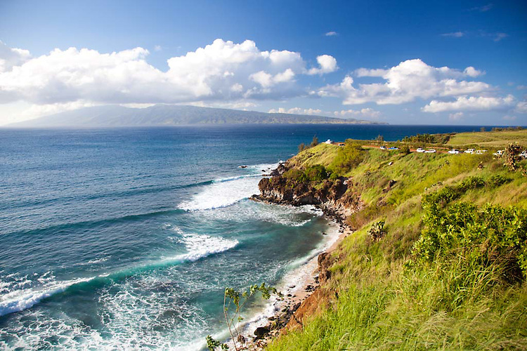 Waves breaking at Honolua Bay on the North shore of West Maui with the island of Molokai in the distance.