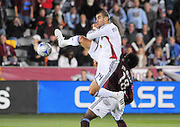 25 October 08: Real Salt Lake forward Yura Movsisyan (14) jumps to control the ball against the Rapids.  Real Salt Lake tied the Colorado Rapids 1-1 at Dick's Sporting Goods Park in Commerce City, Colorado. The tie advanced Real Salt Lake to the playoffs.