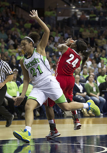 January 13, 2013:  Rutgers forward Shakenag Richardson (24) goes up for a shot as Notre Dame guard Kayla McBride (21) defends during NCAA Basketball game action between the Notre Dame Fighting Irish and the Rutgers Scarlett Knights at Purcell Pavilion at the Joyce Center in South Bend, Indiana.  Notre Dame defeated Rutgers 71-46.