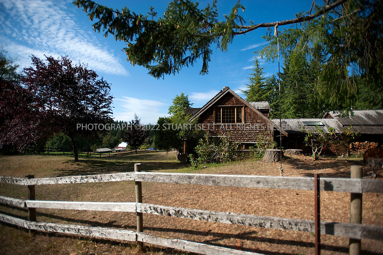8/24/2008--Salt Spring Island, British Columbia, Canada..The main house at the Foxglove Farm on Salt Spring Island, with cabins for guests behind. The produce is grown on Foxglove farm, on Salt Spring Island, one of the Gulf Islands off the coast of Vancouver Island. The farm also offers lodging and cabins...©2009 Stuart Isett. All rights reserved
