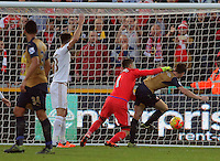 Lukasz Fabianski of Swansea (R) tries to get the ball from infront of Laurent Koscielny of Arsenal who scored during the Barclays Premier League match between Swansea City and Arsenal at the Liberty Stadium, Swansea on October 31st 2015