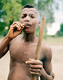 MADAGASCAR, shirtless young man smoking, village of Beza Mahafaly