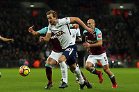 Harry Kane of Tottenham bursts past Pablo Zabaleta of West Ham United during Tottenham Hotspur vs West Ham United, Premier League Football at Wembley Stadium on 4th January 2018
