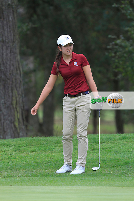 Hannah O'Sullivan (USA) on the 5th hole of the Mixed Fourballs, puts to go two up during the 2014 JUNIOR RYDER CUP at the Blairgowrie Golf Club, Perthshire, Scotland. <br /> Picture:  Thos Caffrey / www.golffile.ie