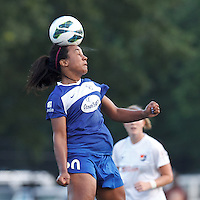 Boston Breakers midfielder Mariah Noguiera (20) heads the ball.  In a National Women's Soccer League (NWSL) match, Boston Breakers (blue) defeated Sky Blue FC (white), 3-2, at Dilboy Stadium on June 30, 2013.