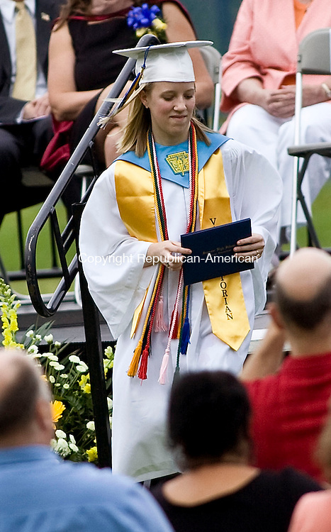 SEYMOUR, CT - 16 JUNE 2010 -061610JT11-<br /> Seymour High School graduate and valedictorian Rebecca Curtis receives her diploma during Wednesday's graduation ceremonies at the school. Curtis will attend UConn in Storrs and pursue a career in accounting.<br /> Josalee Thrift Republican-American