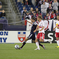 New England Revolution midfielder Chris Tierney (8) dribbles in defensive half as New York Red Bulls midfielder Joel Lindpere (20) pressures. The New England Revolution defeated the New York Red Bulls, 3-2, at Gillette Stadium on May 29, 2010.
