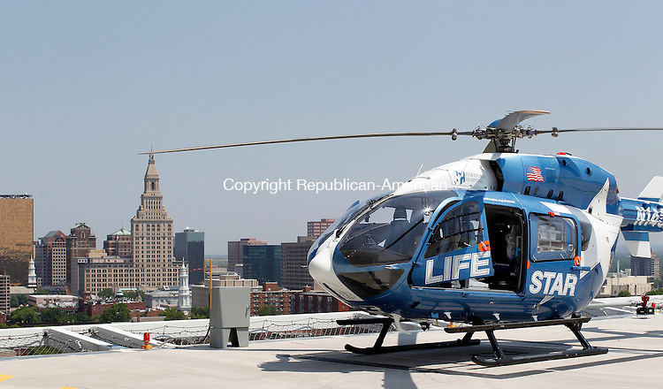 Hartford, CT-26, May 2010-052610CM02 Life Star, a medical transport helicopter that serves Connecticut and the northeast, waits for a call ontop of Hartford Hospital.  Hartford Hospital will celebrate 25 years of the helo's service next month. --Christopher Massa Republican-American