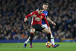 Henrik Mkhitaryan of Manchester United and Tom Cleverley of Everton during the Premier League match at Goodison Park, Liverpool. Picture date: December 4th, 2016.Photo credit should read: Lynne Cameron/Sportimage