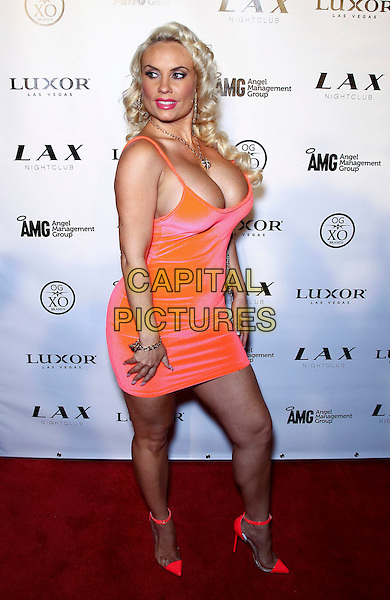 Coco Austin.Ice-T and Coco host a Memorial Day Weekend bash at LAX inside the Luxor Hotel and Casino, Las Vegas, Nevada, USA..May 26th, 2012.full length orange dress cleavage side .CAP/ADM/MJT.© MJT/AdMedia/Capital Pictures.