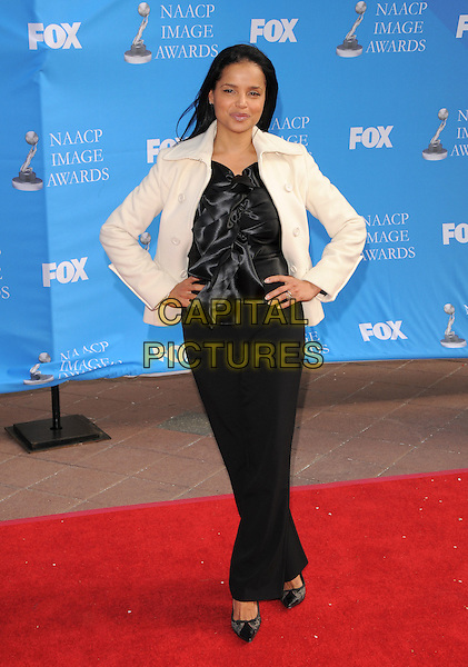 VICTORIA ROSS.Attends The 39th NAACP Image Awards held at The Shrine Auditorium in Los Angeles, California, USA..February 14th, 2008        .full length black trousers top white jacket hands on hips                                                 .CAP/DVS.©Debbie VanStory/Capital Pictures.