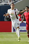21 June 2007:  United States forward Clint Dempsey (8) plays the ball in front of Canada's Ante Jazic (3). The United States Men's National Team defeated the national team of Canada 2-1 in a CONCACAF Gold Cup Semifinal match at Soldier Field in Chicago, Illinois.