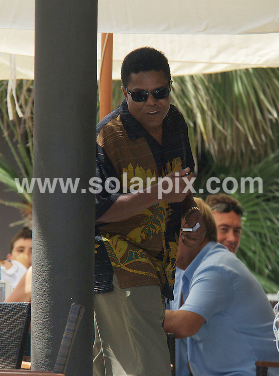 **ALL ROUND PICTURES FROM SOLARPIX.COM**.**WORLDWIDE SYNDICATION RIGHTS**.Tito Jackson having a burger lunch in Puerto Banus Marbella with a girl friend at a beach bar....This pic: Tito Jackson....JOB REF: 9566         JGS        DATE:22.07.09.**MUST CREDIT SOLARPIX.COM OR DOUBLE FEE WILL BE CHARGED**.**ONLINE USAGE FEE GBP 50.00 PER PICTURE - NOTIFICATION OF USAGE TO PHOTO @ SOLARPIX.COM**.**CALL SOLARPIX : +34 952 811 768 or LOW RATE FROM UK 0844 617 7637**