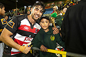 Johnathan Kawau with a fan after the game. Mitre 10 Cup rugby game between Counties Manukau Steelers and Taranaki Bulls, played at Navigation Homes Stadium, Pukekohe on Saturday August 10th 2019. Taranaki won the game 34 - 29 after leading 29 - 19 at halftime.<br /> Photo by Richard Spranger.