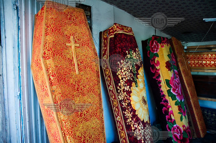 At a coffin makers in Addis Ababa, coffins selling for 50 USD are covered with colourful fabric..