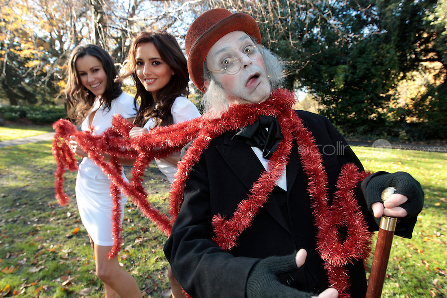 NO FEE PICTURES 14/11/10  Models Nadia Forde and Ally Lacey will be spreading the Christmas Spirit with Meteor when they will put even scrooge in festive form by covering him with tinsel against a Christmas backdrop to launch Meteor's Christmas Advertising Campaign  Picture:Arthur Carron/Collins