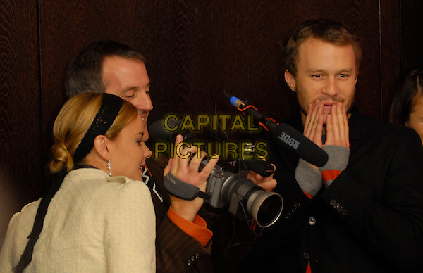 "ABBIE CORNISH & HEATH LEDGER .56th Berlin International Film Festival (Berlinale) promoting ""Candy"", Berlin, Germany..February 15th, 2006.Ref: KRA.half length black suit jacket video camera hands on mouth.www.capitalpictures.com.sales@capitalpictures.com.©Capital Pictures"