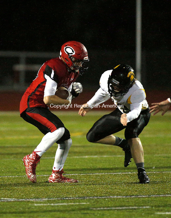 Cheshire, CT- 02 October 2015-100215CM05-  Cheshire's  Mike Millea, left, braces for Amity's Michael Pretlove following a reception during their football matchup in Cheshire on Friday night.    Christopher Massa Republican-American