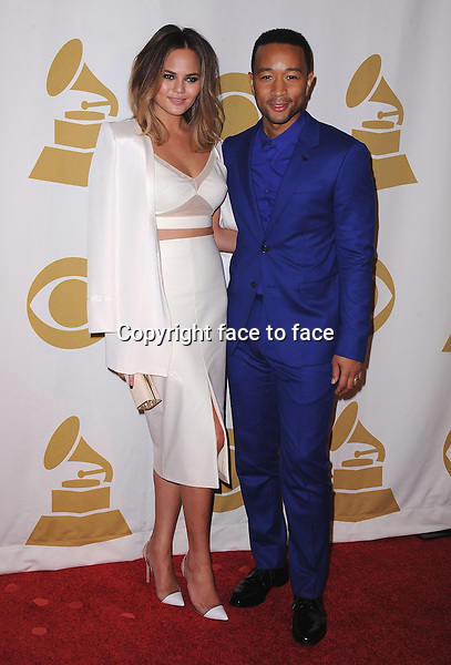 LOS ANGELES, CA - JANUARY 27:  Chrissy Teigen and John Legend arrive at &quot;The Night That Changed America: A Grammy Salute to The Beatles&quot; at the Los Angeles Convention Center West Hall on January 27, 2014 in Los Angeles, California. <br />