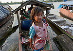 Indigenous people, including this girl, live in their canoes on the Javari River at Atalaia do Norte in Brazil's Amazon region. They travel several days from their villages upstream in order to access government services such as health care in the town.