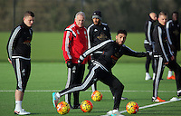 Pictured: Caretaker manager Alan Curtis (C) surrounded by players Franck Tabanou, Ashley Williams and Neil Taylor Wednesday 23 December 2015<br />