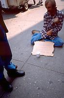 Homeless man 35 begging on sidewalk.  New York New York USA