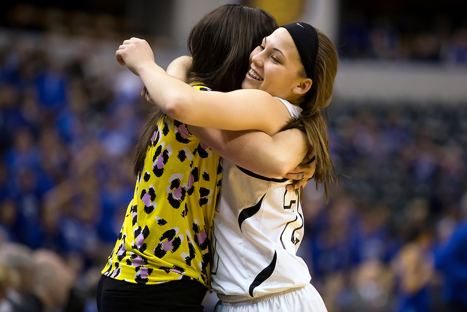 Penn guard Sara Doi (20) hugs coach Kristi Kaniewski UIrich in the closing seconds of a 68-48 win against Columbus North in the IHSAA Class 4A Girls Basketball State Championship Game on Saturday, Feb. 27, 2016, at Bankers Life Fieldhouse in Indianapolis.